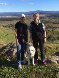 Lindy and Polly with Comet in the middle at the Mt Painter lookout with the Brindabellas behind