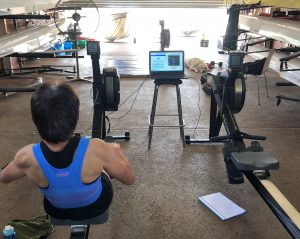 Keeping a close eye on Lindy from a relaxed position while she races on the indoor rowing machine