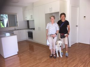 Lindy and Auntie Polly standing with me in between showing off our new kitchen